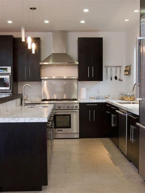 dark kitchen cabinets  white  carrera marble