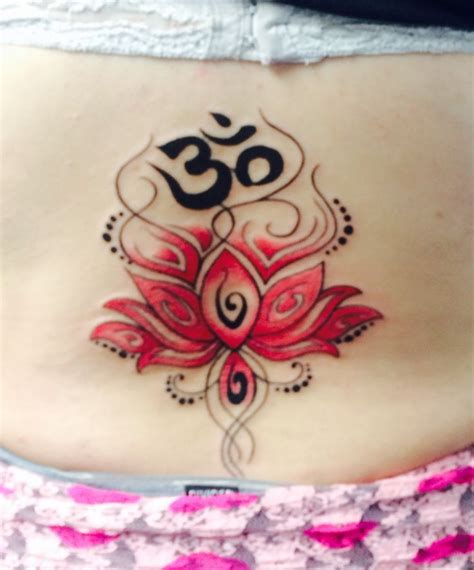ohm tattoo pink lotus flower lower back ohm at the top