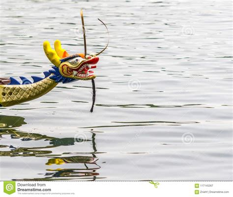 parts of a dragon boat colorful carved dragon head on the front part of a dragon