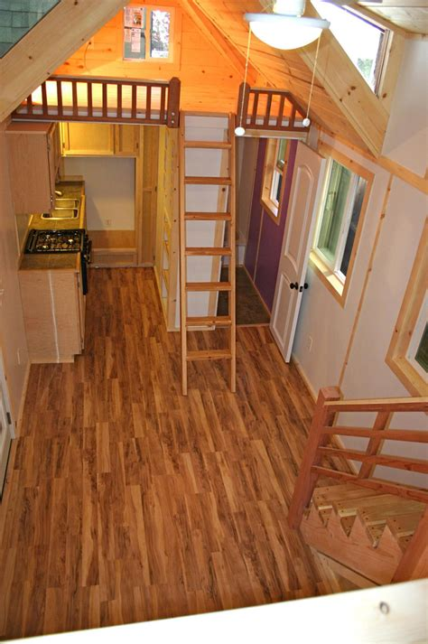 loft homes 322 sq ft tiny house with two lofts that make it look