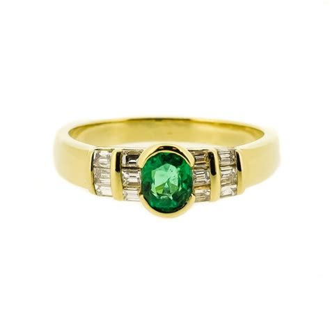 oval emerald baguette ring
