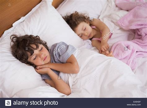 bed and boy and boy sleeping in bed stock photo royalty