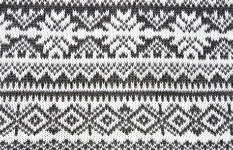snowflake pattern to knit gray background with a knitted pattern to form snowflakes