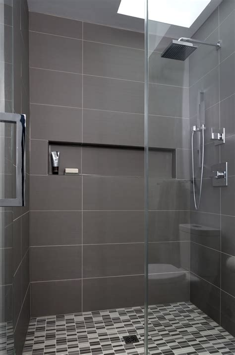 warm gray porcelain tiles create a modern masculine feel in this recent woodley park dc bathroom