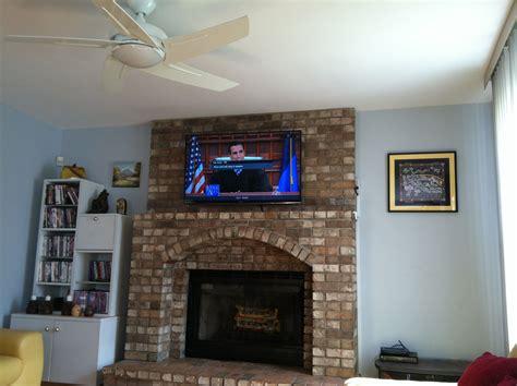 tv installation   brick fireplace  wires