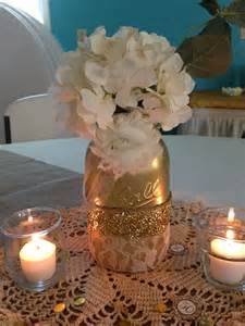 Easy diy centerpiece maybe with a cool case instead of a mason jar