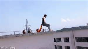 back tattoo man jumping off building moment a suicidal man about to leap off building is saved