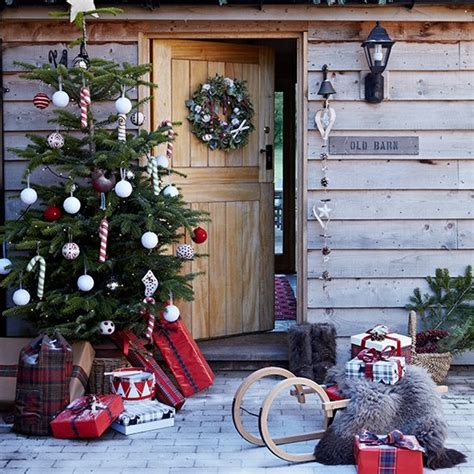 festive entrance with outdoor christmas tree country