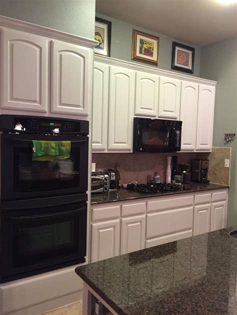what finish paint to use on kitchen cabinets after painted oak kitchen cabinets using fine paints of
