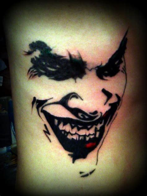 joker batman tattoo designs 26 cool joker tattoos desiznworld