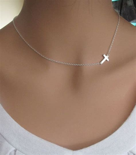 sideways cross tattoo 1000 images about cross around neck on