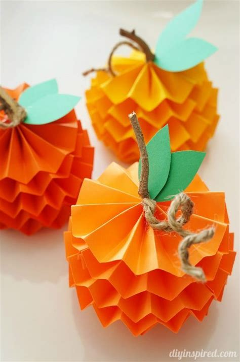Paper Fall Crafts - how to make paper pumpkins for fall diy inspired