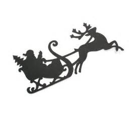santa sleigh and reindeer silhouette items similar to santa claus reindeer silhouette die