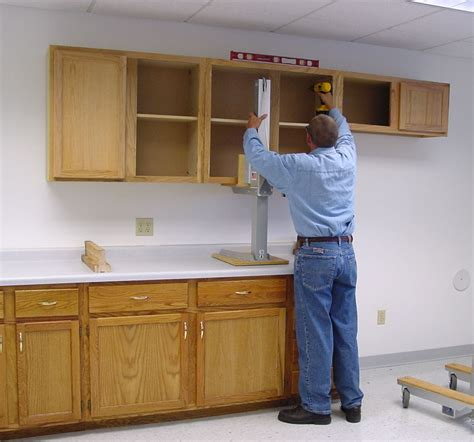 Installing Cabinets by Cabinet Lift Tools Equipment Contractor Talk