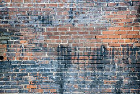 aged brick wall custom wallpaper