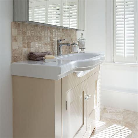 Bathroom with cream and white vanity unit   Decorating