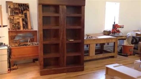 walnut bookcase with secret compartments for