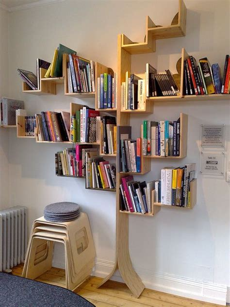 tree bookshelves that creatively display collections in