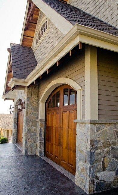 gorgeous wooden garage door  tan accents  exterior