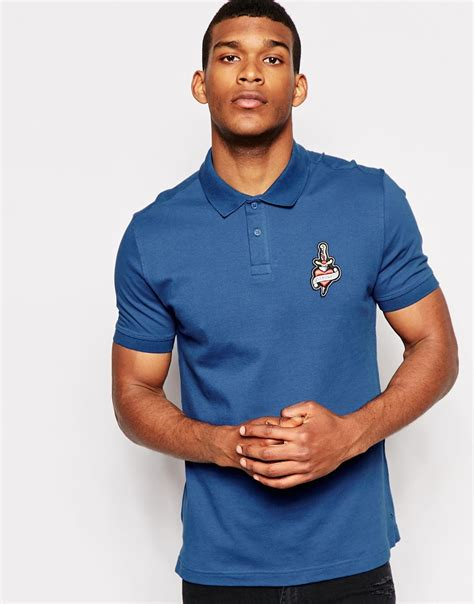 polo tattoo lyst moschino polo t shirt with logo in blue