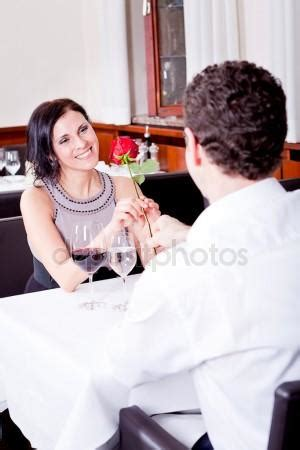 zales commercial actress brunette restaurant table woman drinking wine stock photo 169 nilswey 48675651