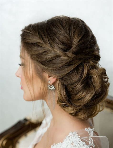 long hair buns for late 30 year old side french braid low wavy bun wedding hairstyle side