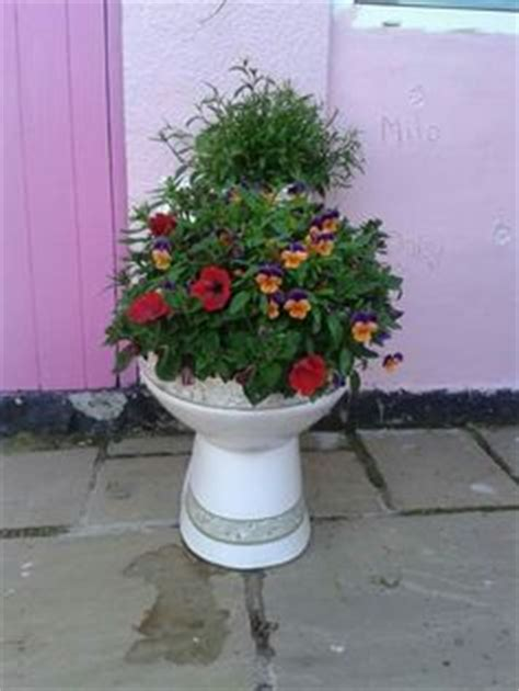 Toilet Flower Planter by Wow Recycled Toilet Tank Gardening Ideas