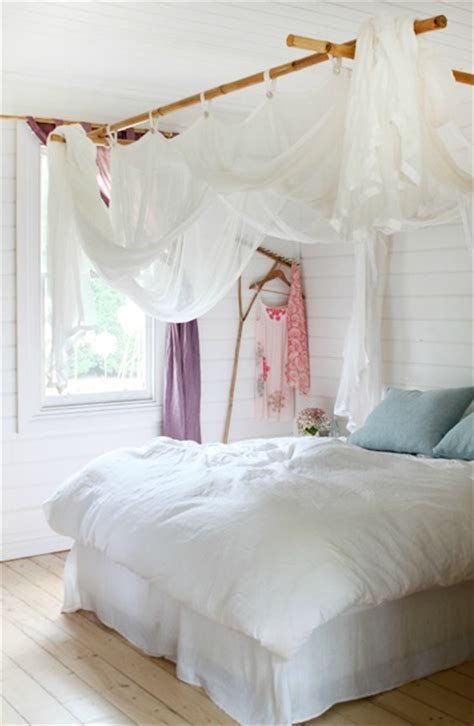 curtain above bed remodelaholic 25 beautiful bed canopies you can diy