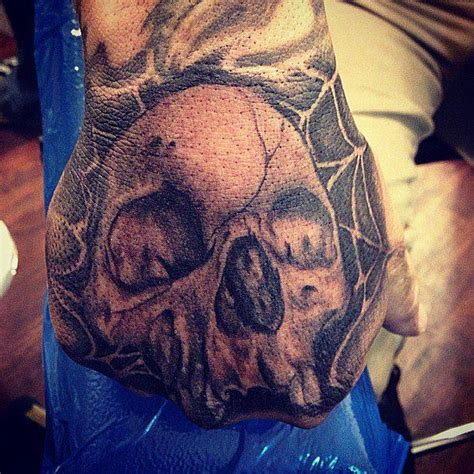 tattoo parlour websites realistic black and gray skull with spider web tattoo