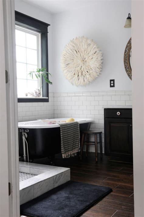 bathrooms with dark wood floors black hex bathroom tile through the front door