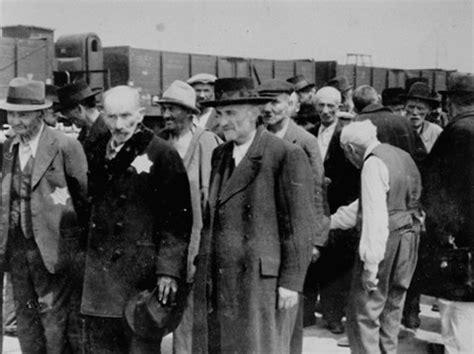 file:russian jews await selection in auschwitz.jpeg
