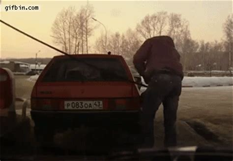 russian guy lifts car at gas station   best funny gifs