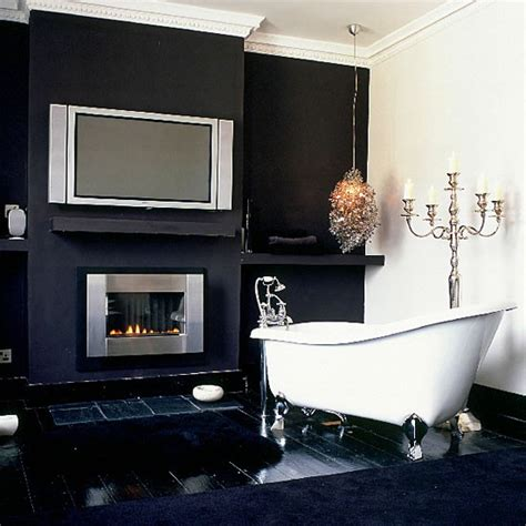 bathroom tv ideas monochrome bathroom with flat screen tv and fireplace