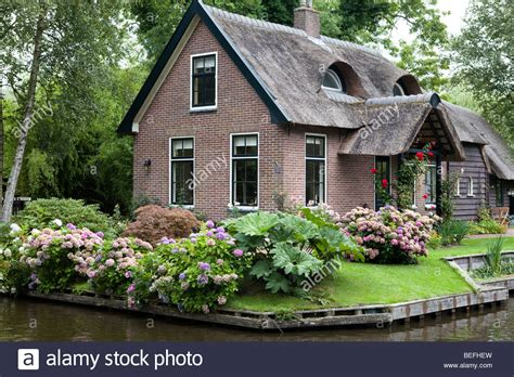 buy house netherlands traditional small village with red brick houses and canals stock photo royalty free