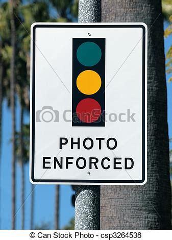 photo enforced traffic light sign. photo enforced traffic