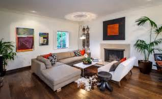 l shaped living room with fireplace and cowhide rug also wood flooring ideas using most popular