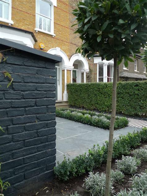 yellow london brick wall black  white victorian mosaic