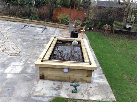 Pond Railway Sleepers by Raised Pond With New Railway Sleepers