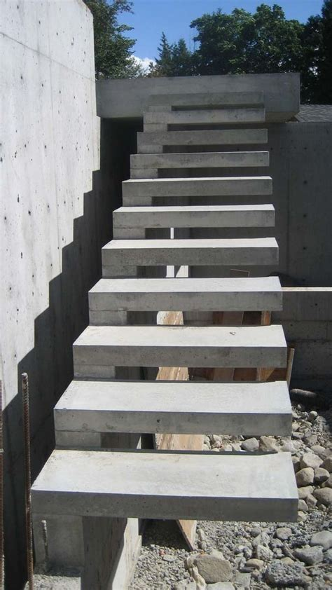 Floating Concrete Stairs And Landing exterior concrete cantilevered stair frontal overview stairs stairs stairs