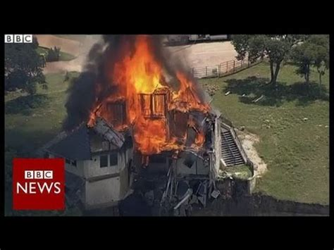 texas house falling off cliff is set on fire bbc news