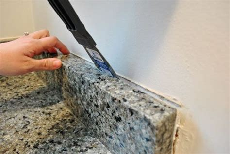 How To Remove Granite Countertop removing the side splash backsplash from our bathroom