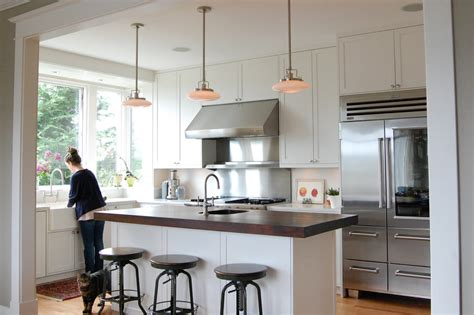 pendant lights cooktop glass door refrigerator kitchen farmhouse with cooktop