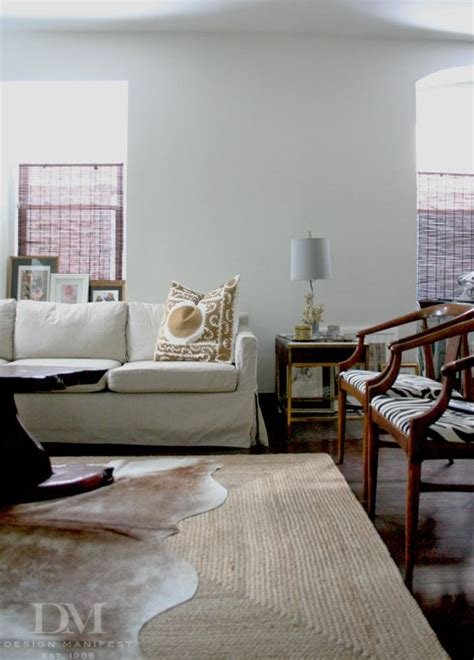 jute rug living room neutral living room via design manifest l i v i n g jute rug chair side