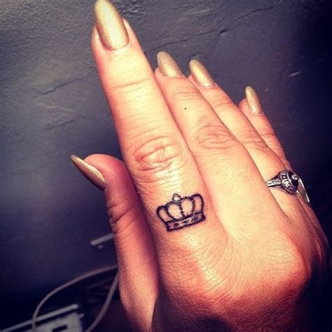 king crown tattoo on finger 48 crown tattoo ideas we love pretty designs