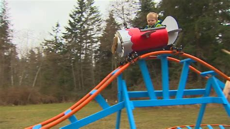 kids backyard roller coaster navy pilot father builds backyard roller coaster for 3