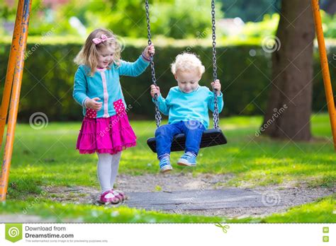 play boy swing videos kids on playground swing stock photo image 72707730
