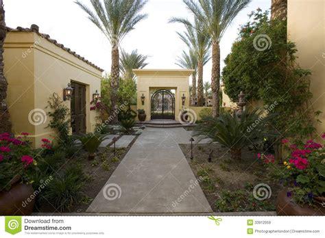 walkway along plants in house garden stock image image