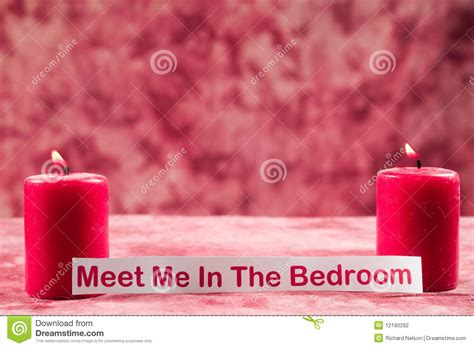 meet me in my bedroom burning candles with note stock photography image 12190292