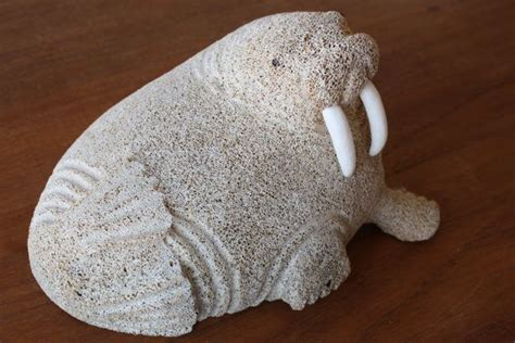 billiken def walrus carving of fossil whale bone with walrus ivory by