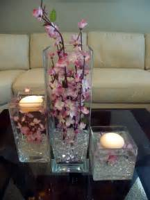 cherry blossoms and floating candles in a 3 square